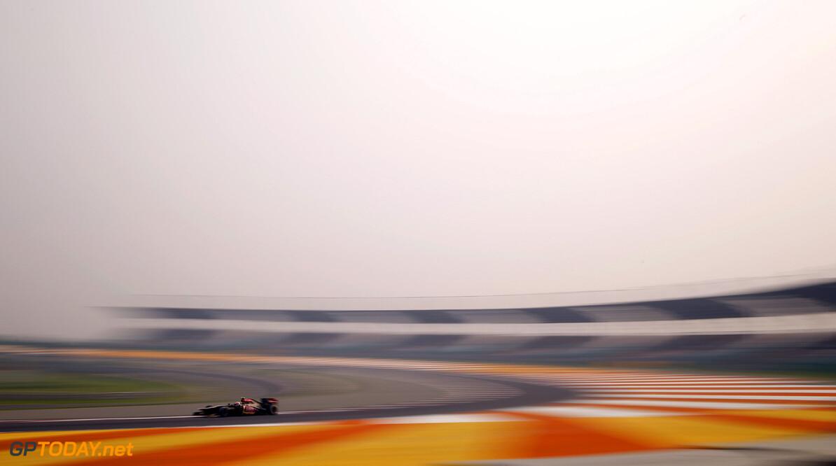 2013 Indian Grand Prix - Friday Buddh International Circuit, New Delhi, India. Friday 25th October 2013. Romain Grosjean, Lotus E21 Renault.  Photo: Glenn Dubar/Lotus F1 Team.  ref: Digital Image _89P5123      formula 1 formula one f1 gp oct ind