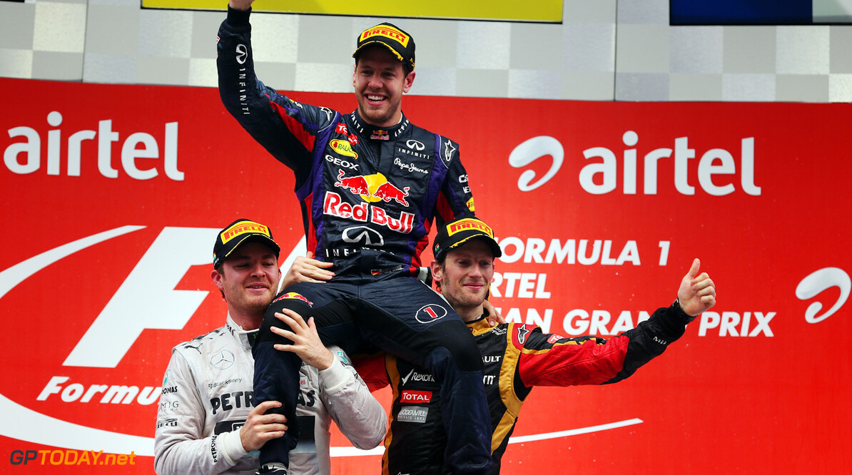 166989286XX00083_F1_Grand_P NOIDA, INDIA - OCTOBER 27:  Race winner and 2013 Formula One World Champion Sebastian Vettel (C) of Germany and Infiniti Red Bull Racing is lifted up by second placed Nico Rosberg (L) of Germany and Mercedes GP and third placed Romain Grosjean (R) of France and Lotus following the Indian Formula One Grand Prix at Buddh International Circuit on October 27, 2013 in Noida, India.  (Photo by Mark Thompson/Getty Images) *** Local Caption *** Sebastian Vettel; Nico Rosberg; Romain Grosjean F1 Grand Prix of India - Race Mark Thompson Noida India  Delhi