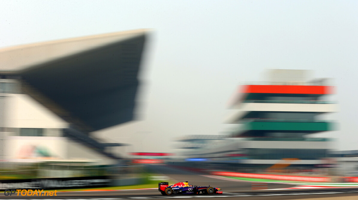 166989273XX00150_F1_Grand_P NOIDA, INDIA - OCTOBER 26:  Sebastian Vettel of Germany and Infiniti Red Bull Racing drives on his way to finishing first during qualifying for the Indian Formula One Grand Prix at Buddh International Circuit on October 26, 2013 in Noida, India.  (Photo by Paul Gilham/Getty Images) *** Local Caption *** Sebastian Vettel F1 Grand Prix of India - Qualifying Paul Gilham Noida India  Delhi