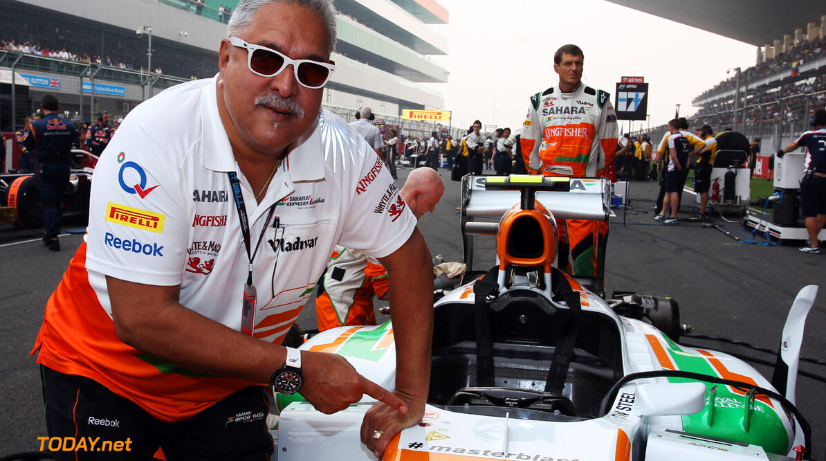 Formula One World Championship Dr. Vijay Mallya (IND) Sahara Force India F1 Team Owner on the grid with the Sahara Force India VJM06 carrying the hashtag # masterblaster as a tribute to the legendary crickerter Sachin Tendulkar, who has recently announced his retirement from all forms of cricket.