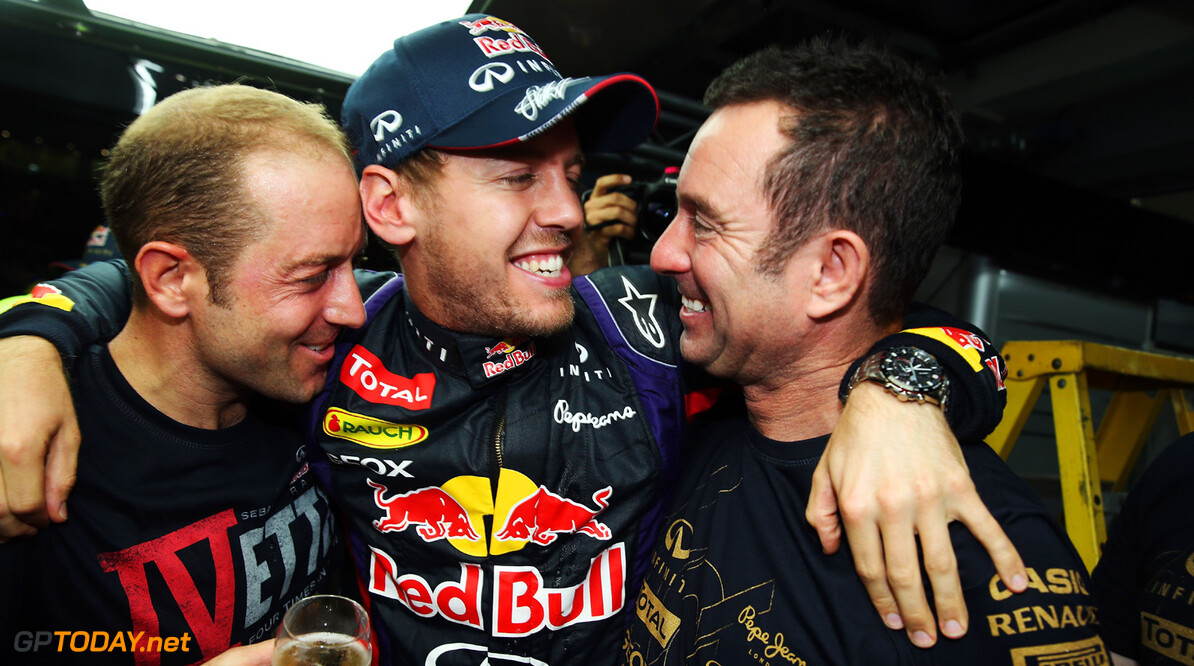 166989286XX00160_F1_Grand_P NOIDA, INDIA - OCTOBER 27:  Race winner and 2013 Formula One World Champion Sebastian Vettel of Germany and Infiniti Red Bull Racing celebrates with team mates following the Indian Formula One Grand Prix at Buddh International Circuit on October 27, 2013 in Noida, India.  (Photo by Mark Thompson/Getty Images) *** Local Caption *** Sebastian Vettel F1 Grand Prix of India - Race Mark Thompson Noida India  Delhi
