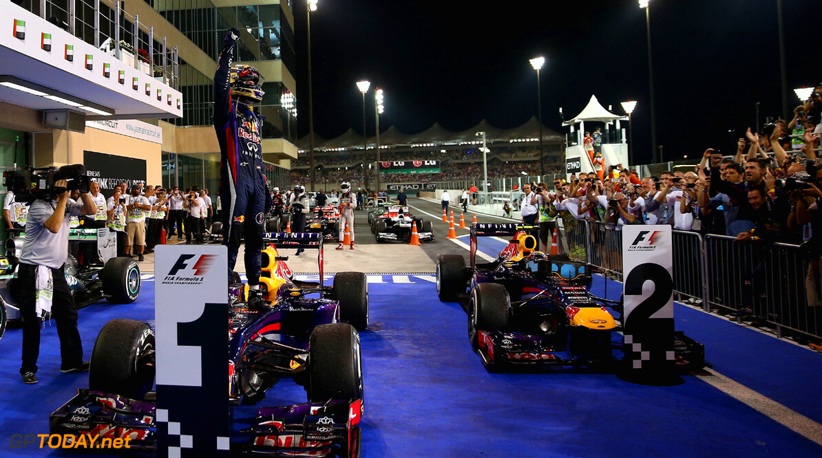 166989348XX00064_F1_Grand_P ABU DHABI, UNITED ARAB EMIRATES - NOVEMBER 03:  Sebastian Vettel of Germany and Infiniti Red Bull Racing celebrates in parc ferme after winning the Abu Dhabi Formula One Grand Prix at the Yas Marina Circuit on November 3, 2013 in Abu Dhabi, United Arab Emirates.  (Photo by Paul Gilham/Getty Images) *** Local Caption *** Sebastian Vettel F1 Grand Prix of Abu Dhabi - Race Paul Gilham Abu Dhabi United Arab Emirates