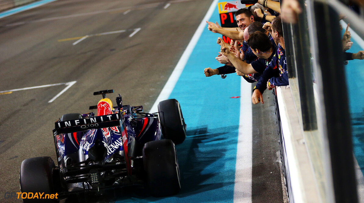 166989348XX00059_F1_Grand_P ABU DHABI, UNITED ARAB EMIRATES - NOVEMBER 03:  Sebastian Vettel of Germany and Infiniti Red Bull Racing celebrates in front of team mates as he crosses the finishing line to win the Abu Dhabi Formula One Grand Prix at the Yas Marina Circuit on November 3, 2013 in Abu Dhabi, United Arab Emirates.  (Photo by Mark Thompson/Getty Images) *** Local Caption *** Sebastian Vettel F1 Grand Prix of Abu Dhabi - Race Mark Thompson Abu Dhabi United Arab Emirates