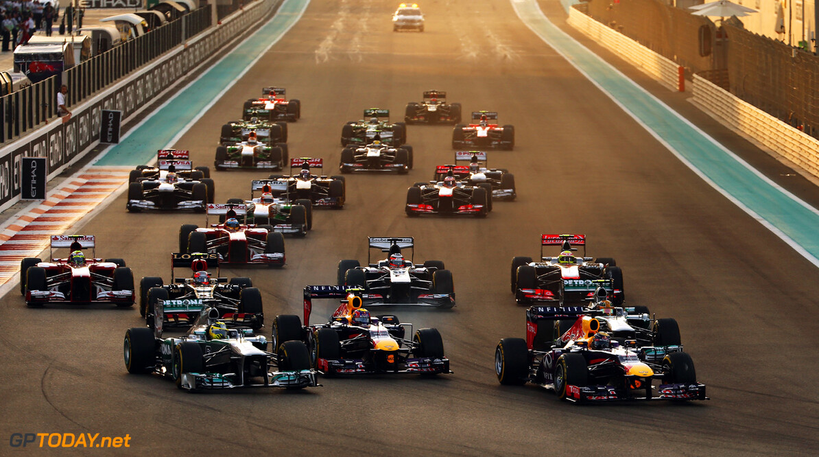 166989348XX00026_F1_Grand_P ABU DHABI, UNITED ARAB EMIRATES - NOVEMBER 03:  Sebastian Vettel (front right) of Germany and Infiniti Red Bull Racing leads the field into the first corner at the start of the Abu Dhabi Formula One Grand Prix at the Yas Marina Circuit on November 3, 2013 in Abu Dhabi, United Arab Emirates.  (Photo by Mark Thompson/Getty Images) *** Local Caption *** Sebastian Vettel F1 Grand Prix of Abu Dhabi - Race Mark Thompson Abu Dhabi United Arab Emirates