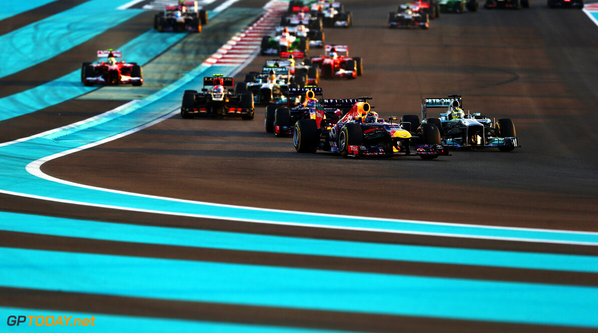 166989348XX00029_F1_Grand_P ABU DHABI, UNITED ARAB EMIRATES - NOVEMBER 03:  Sebastian Vettel (front left) of Germany and Infiniti Red Bull Racing leads the field through turns one and two at the start of the Abu Dhabi Formula One Grand Prix at the Yas Marina Circuit on November 3, 2013 in Abu Dhabi, United Arab Emirates.  (Photo by Paul Gilham/Getty Images) *** Local Caption *** Sebastian Vettel F1 Grand Prix of Abu Dhabi - Race Paul Gilham Abu Dhabi United Arab Emirates