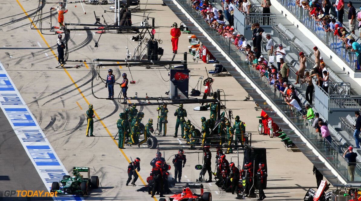 Formula One World Championship Jules Bianchi (FRA) Marussia F1 Team MR02 makes a pit stop.