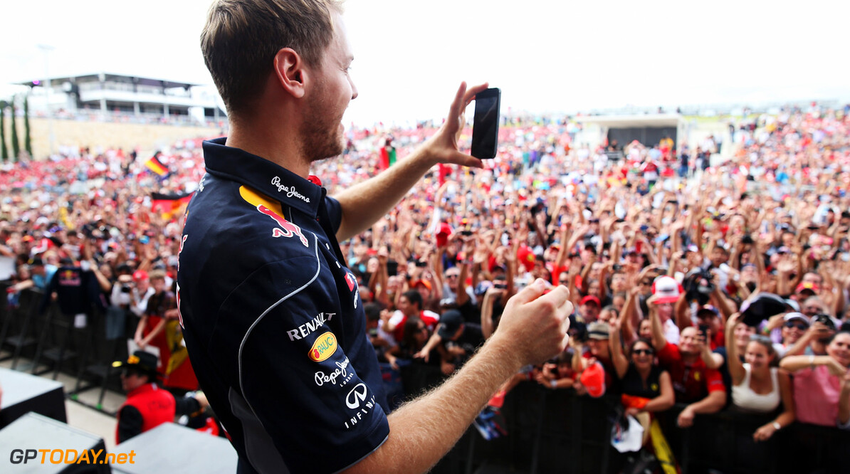 166989396KR00212_F1_Grand_P AUSTIN, TX - NOVEMBER 16:  Sebastian Vettel of Germany and Infiniti Red Bull Racing takes a picture of the crowd at the drivers autograph session following qualifying for the United States Formula One Grand Prix at Circuit of The Americas on November 16, 2013 in Austin, United States.  (Photo by Mark Thompson/Getty Images) *** Local Caption *** Sebastian Vettel F1 Grand Prix of USA - Qualifying Mark Thompson Austin United States  F1 Formula One