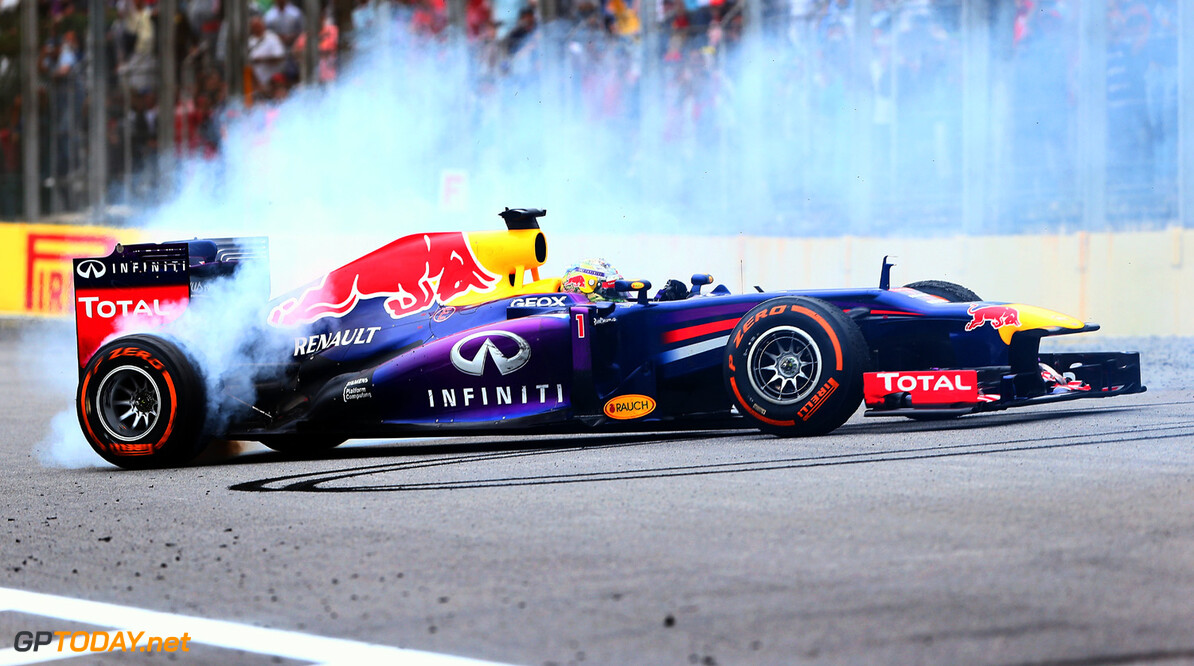 166989451XX00057_F1_Grand_P SAO PAULO, BRAZIL - NOVEMBER 24:  Sebastian Vettel of Germany and Infiniti Red Bull Racing performs donuts in his car after winning the Brazilian Formula One Grand Prix at Autodromo Jose Carlos Pace on November 24, 2013 in Sao Paulo, Brazil.  (Photo by Clive Mason/Getty Images) *** Local Caption *** Sebastian Vettel F1 Grand Prix of Brazil - Race Clive Mason Sao Paulo Brazil  Interlagos