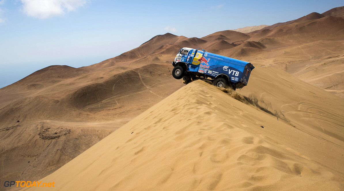 Eduard Nikolaev (driver) Evgeny Yakovlev (co-driver) and Vladimir Rybakov (co-driver) race during the 9th stage of Dakar Rally from Calama to Iquique, Chile on January 14th, 2014 // Marcelo Maragni/Red Bull Content Pool // P-20140114-00188 // Usage for editorial use only // Please go to www.redbullcontentpool.com for further information. // Eduard Nikolaev - Action  Calama Argentina  P-20140114-00188