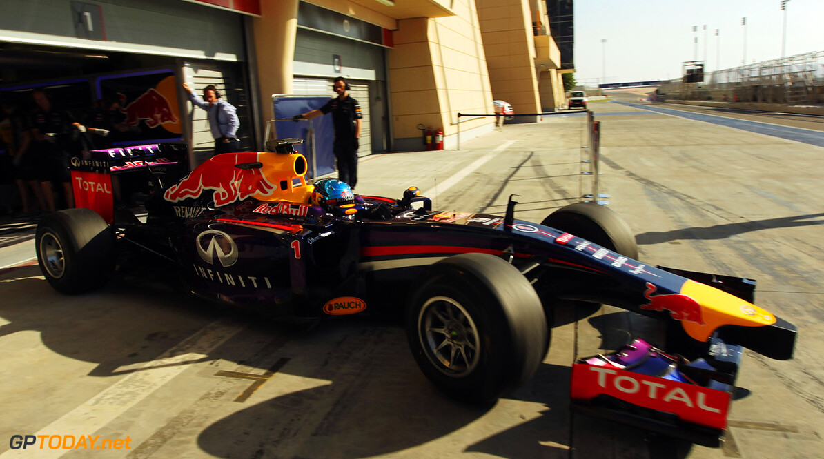469756541XX00091_F1_Testing BAHRAIN, BAHRAIN - FEBRUARY 19:  Sebastian Vettel of Germany and Infiniti Red Bull Racing exits his garage to drive during day one of Formula One Winter Testing at the Bahrain International Circuit on February 19, 2014 in Bahrain, Bahrain.  (Photo by Ker Robertson/Getty Images) *** Local Caption *** Sebastian Vettel F1 Testing in Bahrain - Day One Ker Robertson Bahrain Bahrain  Formula One Racing
