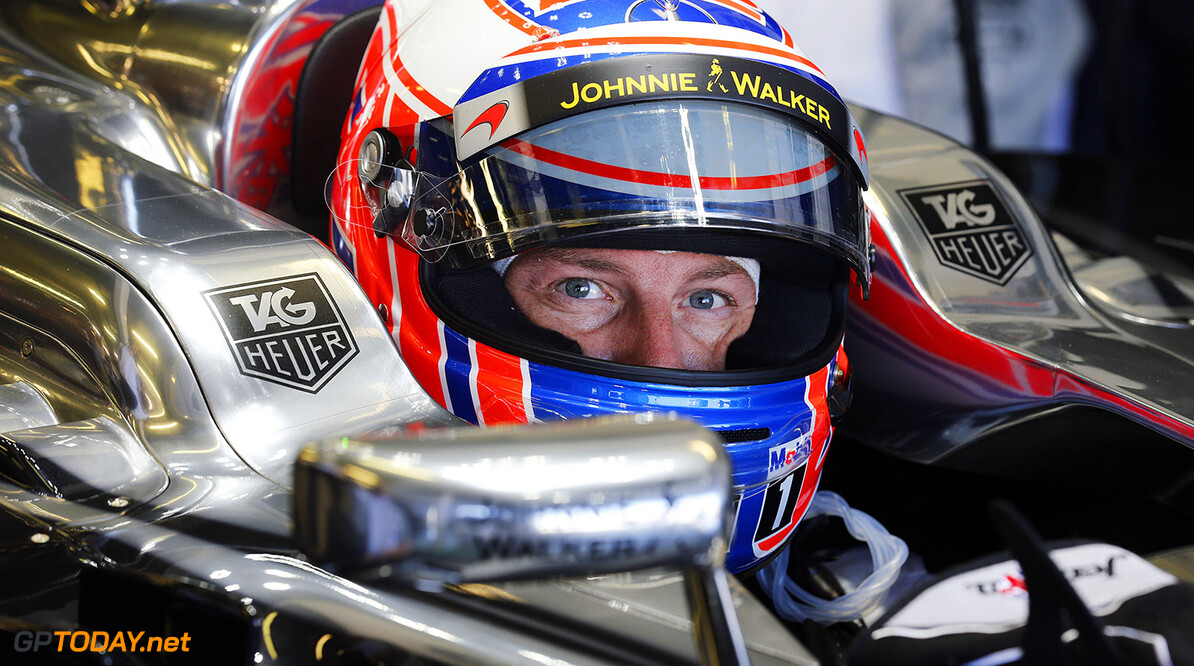 Jenson Button waits in his car in the garage.