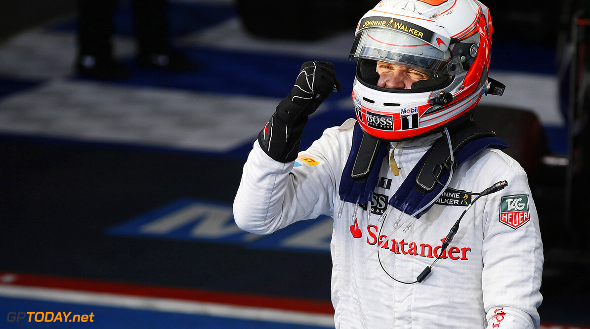 Kevin Magnussen celebrates his podium finish.