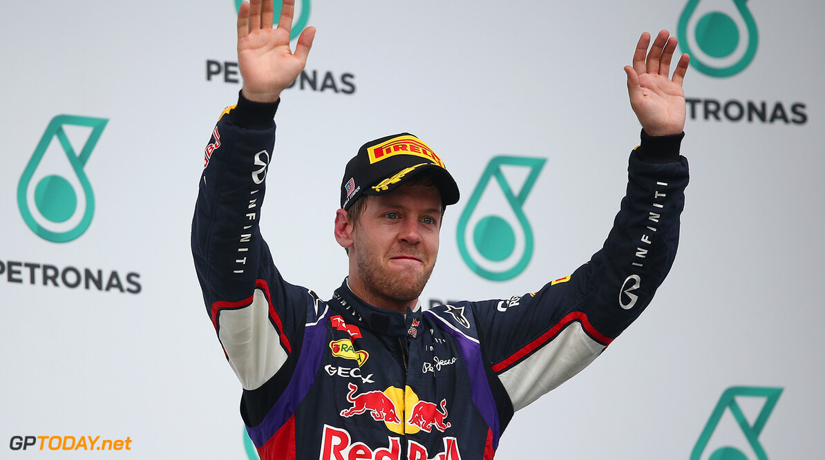 479868513MT00195_F1_Grand_P KUALA LUMPUR, MALAYSIA - MARCH 30:  Third placed Sebastian Vettel of Germany and Infiniti Red Bull Racing celebrates on the podium after the Malaysia Formula One Grand Prix at the Sepang Circuit on March 30, 2014 in Kuala Lumpur, Malaysia.  (Photo by Clive Mason/Getty Images) *** Local Caption *** Sebastian Vettel F1 Grand Prix of Malaysia - Race Clive Mason Kuala Lumpur Malaysia  Formula One Racing formula 1 Auto Racing Malaysia F1 Grand Prix Malaysian Formula One Grand Prix Formula One Grand Prix