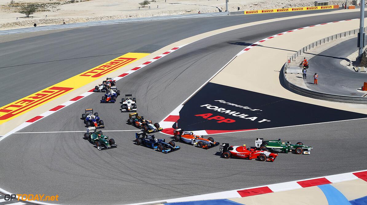 2014 GP2 Series Round 1 Bahrain International Circuit, Bahrain Sunday 6 April 2014. Andre Negrao (BRA, Arden International) & Rio Haryanto (INA, EQ8 Caterham Racing) battle for position World Copyright: Sam Bloxham/LAT Photographic. ref: Digital Image _SBL7442  Sam Bloxham    Race Two