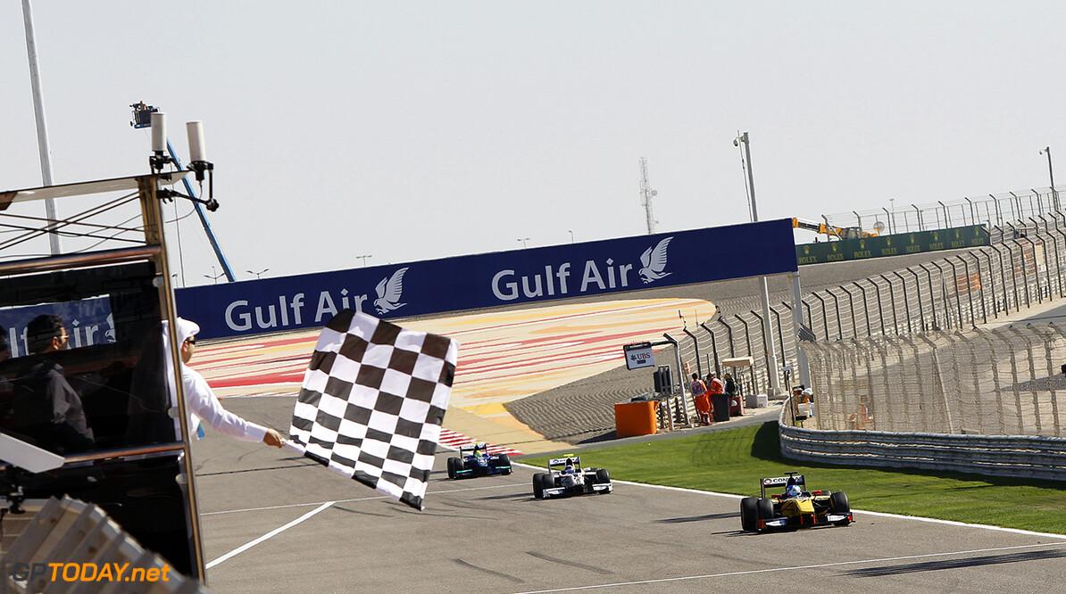 2014 GP2 Series Round 1 Bahrain International Circuit, Bahrain Sunday 6 April 2014. Jolyon Palmer (GBR, DAMS), 1st, Simon Trummer (SUI, Rapax), 2nd, & Julian Leal (COL, Carlin), 3rd, take the chequered flag World Copyright: Sam Bloxham/LAT Photographic. ref: Digital Image _G7C3481  Sam Bloxham    Race Two