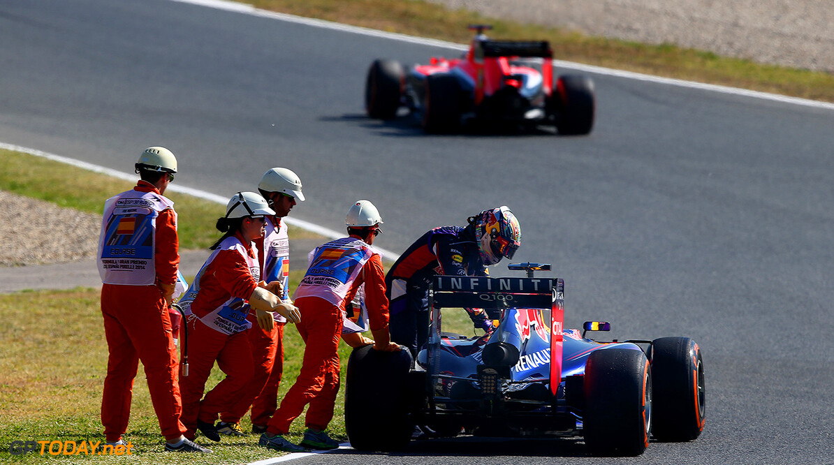 MONTMELO, SPAIN - MAY 09:  Sebastian Vettel of Germany and Infiniti Red Bull Racing helps to push his car off the track after breaking down during practice ahead of the Spanish F1 Grand Prix at Circuit de Catalunya on May 9, 2014 in Montmelo, Spain.  (Photo by Clive Mason/Getty Images) *** Local Caption *** Sebastian Vettel Spanish F1 Grand Prix - Practice Clive Mason Montmelo Spain  Formula One Racing formula 1 Auto Racing Spain F1 Grand Prix Spanish Formula One Grand Prix Formula One Grand Prix Barcelona