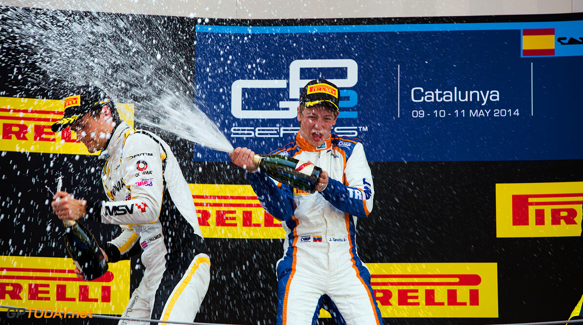 2014 GP2 Series Round 2 - Race 1. Circuit de Catalunya, Barcelona, Spain. Saturday 10 May 2014. Johnny Cecotto (VEN, Trident) & Jolyon Palmer (GBR, DAMS) spray champagne Photo: Malcolm Griffiths/GP2 Series Media Service. ref: Digital Image A50A3186   Malcolm Griffiths