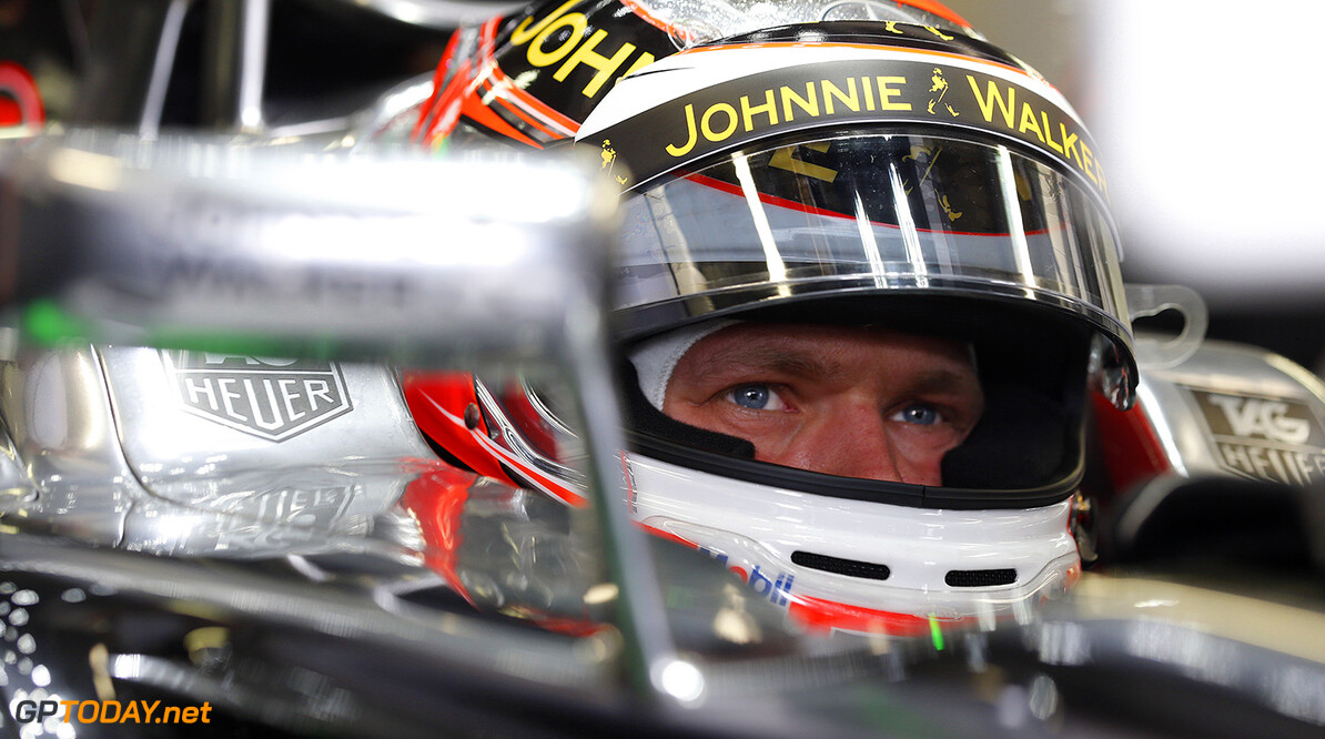 Kevin Magnussen waits in his car in the garage.