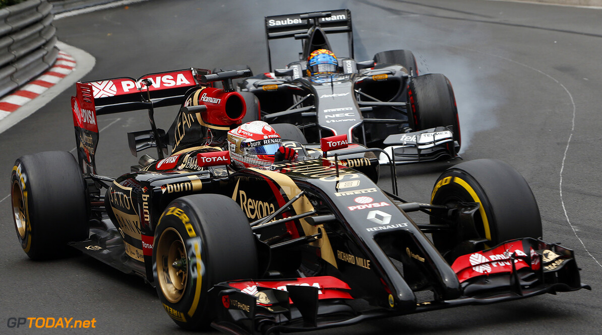 Monte Carlo, Monaco. Sunday 25 May 2014. Romain Grosjean, Lotus E22 Renault, leads Adrian Sutil, Sauber C33 Ferrari. Photo: Alastair Staley/Lotus F1 Team. ref: Digital Image _R6T1874  Al Staley    f1 formula 1 formula one gp grand prix Action