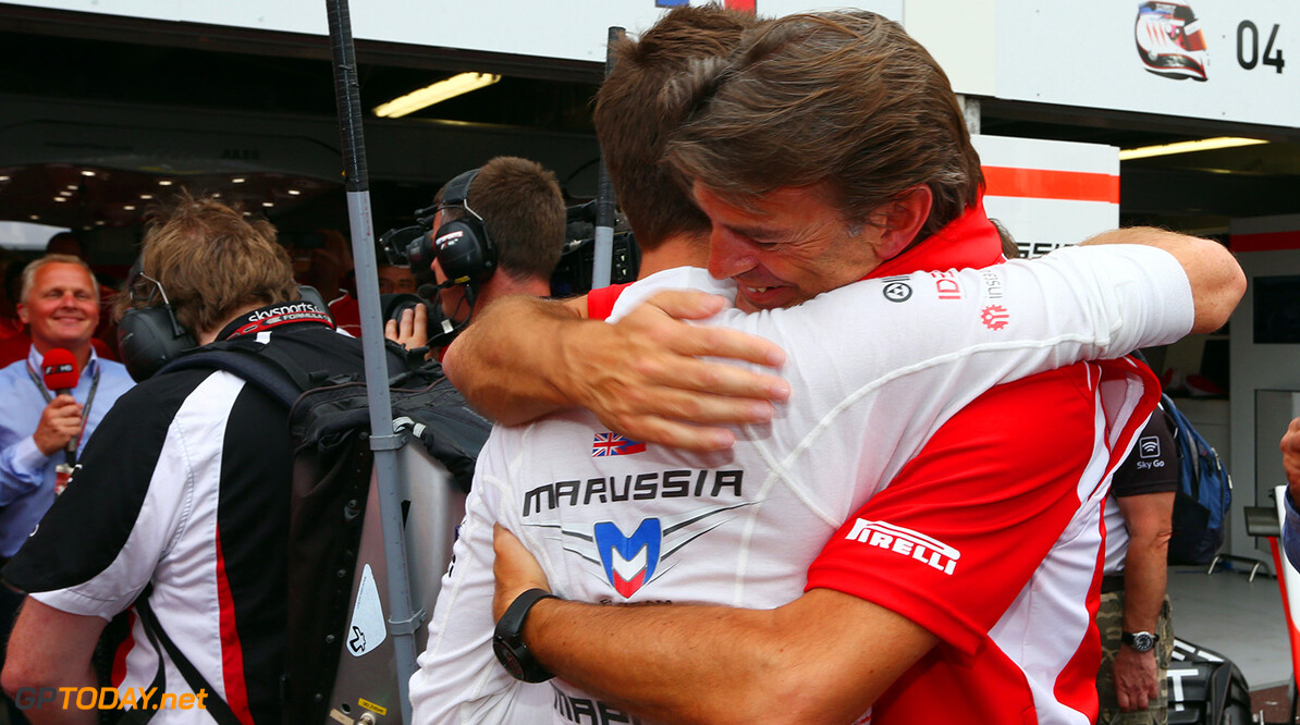 Formula One World Championship Jules Bianchi (FRA) Marussia F1 Team celebrates his and the team's first F1 points with Graeme Lowdon (GBR) Marussia F1 Team Chief Executive Officer.