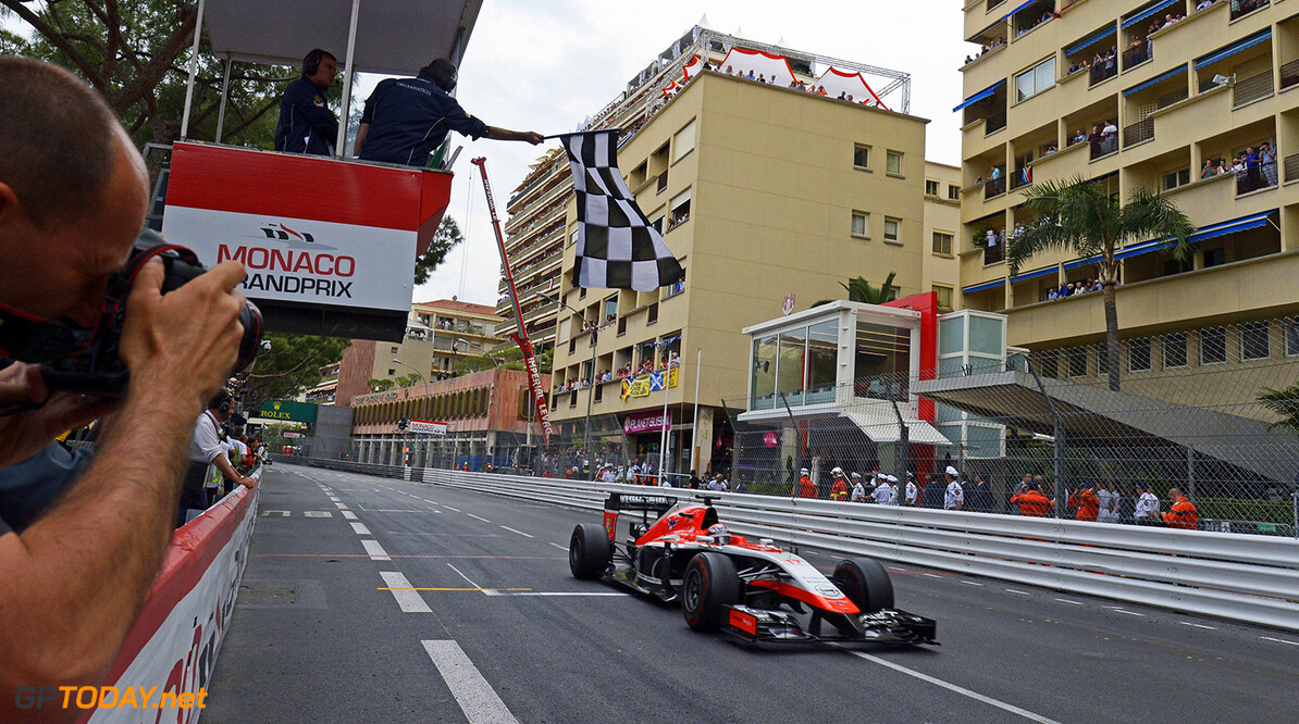Formula One World Championship Jules Bianchi (FRA) Marussia F1 Team MR03 takes the chequered flag at the end of the race to score the team's first F1 points.