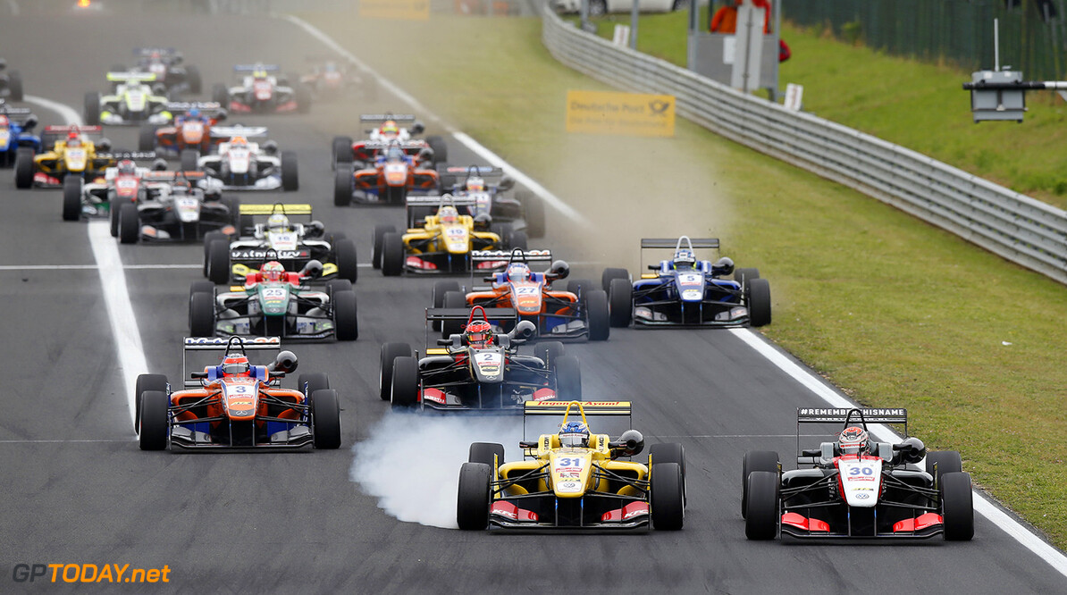 FIA Formula 3 European Championship, round 4, race 1, Hungarorin Start of the race, 31 Tom Blomqvist (GBR, Jagonya Ayam with Carlin, Dallara F312 - Volkswagen) taking the lead from 30 Max Verstappen (NLD, Van Amersfoort Racing, Dallara F312 - Volkswagen), FIA Formula 3 European Championship, round 4, race 1, Hungaroring (HUN) - 30. May - 1. June 2014 FIA Formula 3 European Championship, round 4, race 1, Hungaroring (HUN) Thomas Suer Budapest Hungary
