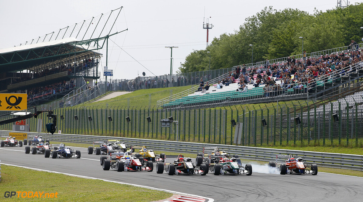 FIA Formula 3 European Championship, round 4, race 2, Hungarorin Start of the race, 2 Esteban Ocon (FRA, Prema Powerteam, Dallara F312 - Mercedes) taking the lead from 25 Antonio Fuoco (ITA, Prema Powerteam, Dallara F312 - Mercedes) and 3 Lucas Auer (AUT, kfzteile24 Mucke Motorsport, Dallara F312 - Mercedes), FIA Formula 3 European Championship, round 4, race 2, Hungaroring (HUN) - 30. May - 1. June 2014 FIA Formula 3 European Championship, round 4, race 2, Hungaroring (HUN) Thomas Suer Budapest Hungary