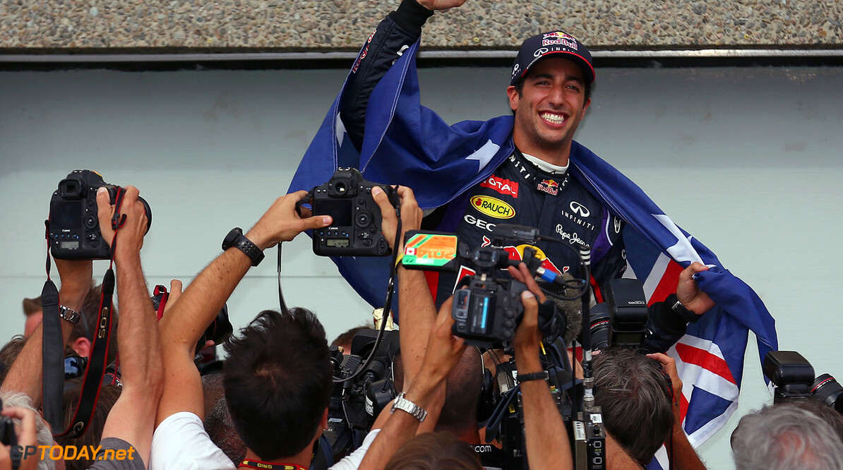 MONTREAL, QC - JUNE 08:  Racewinner Daniel Ricciardo of Australia and Infiniti Red Bull Racing is carried aloft by his pit crew following his frst grand prix victory during the Canadian Formula One Grand Prix at Circuit Gilles Villeneuve on June 8, 2014 in Montreal, Canada.  (Photo by Tom Pennington/Getty Images) *** Local Caption *** Daniel Ricciardo Canadian F1 Grand Prix Tom Pennington Montreal Canada  Formula One Racing formula 1 Auto Racing Formula One Grand Prix Canadian F1 Grand Prix Canadian Formula One Grand Prix