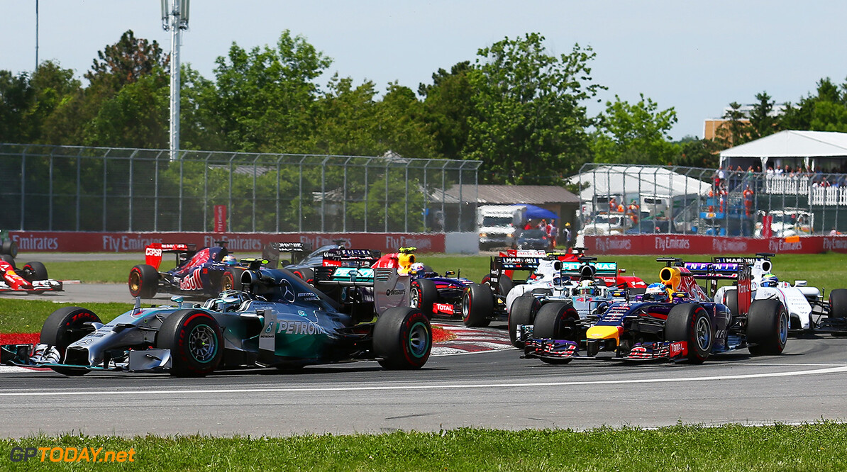 MONTREAL, QC - JUNE 08:  Nico Rosberg of Germany and Mercedes GP leads Sebastian Vettel of Germany and Infiniti Red Bull Racing out of the second corner during the Canadian Formula One Grand Prix at Circuit Gilles Villeneuve on June 8, 2014 in Montreal, Canada.  (Photo by Tom Pennington/Getty Images) *** Local Caption *** Nico Rosberg;Sebastian Vettel Canadian F1 Grand Prix Tom Pennington Montreal Canada  Formula One Racing formula 1 Auto Racing Formula One Grand Prix Canadian F1 Grand Prix Canadian Formula One Grand Prix