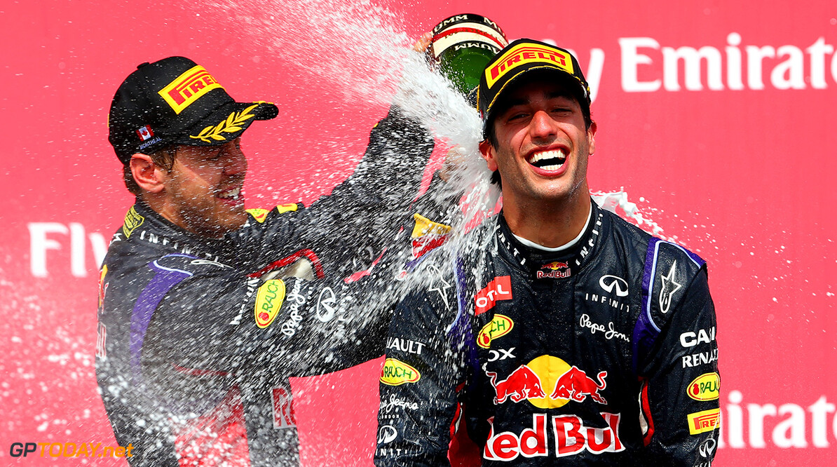 MONTREAL, QC - JUNE 08:  Racewinner Daniel Ricciardo of Australia and Infiniti Red Bull Racing is sprayed with champagne by teammate Sebastian Vettel of Germany and Infiniti Red Bull Racing following his victory during the Canadian Formula One Grand Prix at Circuit Gilles Villeneuve on June 8, 2014 in Montreal, Canada.  (Photo by Mark Thompson/Getty Images) *** Local Caption *** Daniel Ricciardo;Sebastian Vettel Canadian F1 Grand Prix Mark Thompson Montreal Canada  Formula One Racing formula 1 Auto Racing Formula One Grand Prix Canadian F1 Grand Prix Canadian Formula One Grand Prix