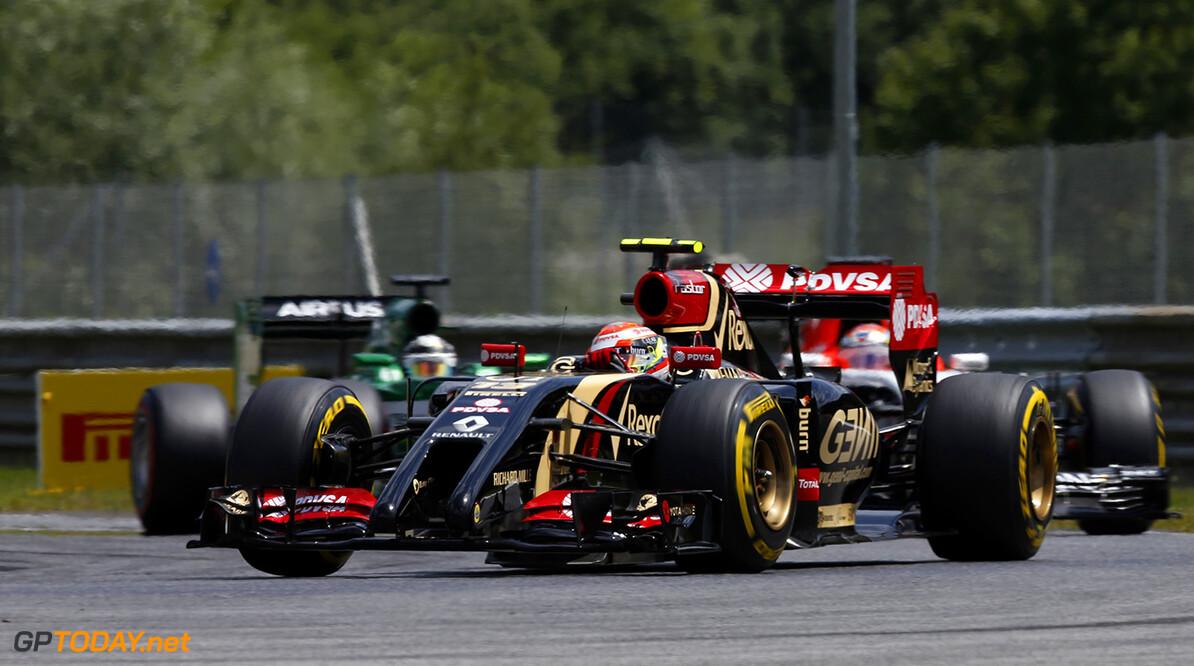 _J5R0725.jpg Red Bull Ring, Spielberg, Austria. Sunday 22 June 2014. Pastor Maldonado, Lotus E22 Renault, leads Kamui Kobayashi, Caterham CT05 Renault. World Copyright: Charles Coates/LAT Photographic. ref: Digital Image _J5R0725 -------------------- Charles Coates / Lotus F1 2014 FIA Formula One World Championship Austrian Grand Prix 22 June 2014 (C)2014 Charles Coates / Lotus F1 all rights reserved Red Bull Ring, Spielberg, Austria. Sunday 22 June 2014. Pastor Maldonado, Lotus E22 Renault, leads Kamui Kobayashi, Caterham CT05 Renault. World Copyright: Charles Coates/LAT Photographic. ref: Digital Image _J5R0725 Charles Coates    f1 formula 1 formula one gp aut action