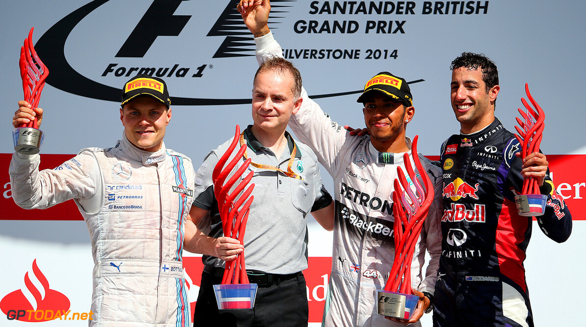 NORTHAMPTON, ENGLAND - JULY 06:  Lewis Hamilton of Great Britain and Mercedes GP celebrates on the podium next to Valtteri Bottas of Finland and Williams and Daniel Ricciardo of Australia and Infiniti Red Bull Racing after winning the British Formula One Grand Prix at Silverstone Circuit on July 6, 2014 in Northampton, United Kingdom.  (Photo by Mark Thompson/Getty Images) *** Local Caption *** Lewis Hamilton;Daniel Ricciardo;Valtteri Bottas F1 Grand Prix of Great Britain Mark Thompson Northampton United Kingdom  Formula One Racing formula 1 Auto Racing Formula One Grand Prix Silverstone Circuit British GP British Formula One Grand Prix