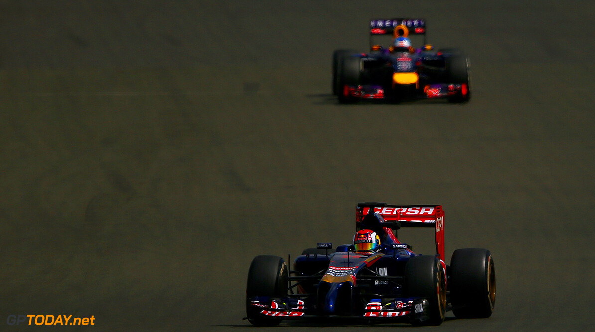 NORTHAMPTON, ENGLAND - JULY 09:  Daniil Kvyat of Russia and Scuderia Toro Rosso drives ahead of Sebastian Vettel of Germany and Infiniti Red Bull Racing during day two of testing at Silverstone Circuit on July 9, 2014 in Northampton, England.  (Photo by Dan Istitene/Getty Images) *** Local Caption *** Sebastian Vettel;Daniil Kvyat F1 Testing At Silverstone - Day Two Dan Istitene Northampton United Kingdom  Formula One Racing formula 1 Auto Racing Formula One Grand Prix Silverstone Circuit British GP British Formula One Grand Prix