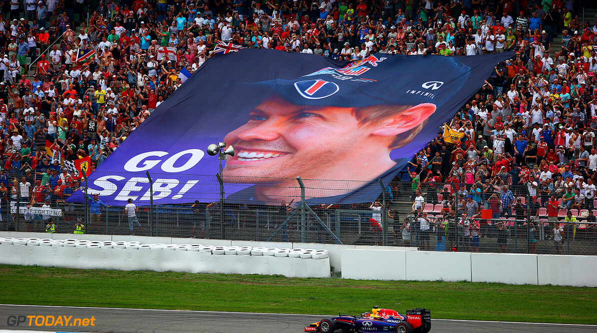 HOCKENHEIM, GERMANY - JULY 20:  Sebastian Vettel of Germany and Infiniti Red Bull Racing drives past a large banner unfurled by his fans displaying a large image of him during the German Grand Prix at Hockenheimring on July 20, 2014 in Hockenheim, Germany.  (Photo by Dan Istitene/Getty Images) *** Local Caption *** Sebastian Vettel F1 Grand Prix of Germany Dan Istitene Hockenheim Germany  Formula One Racing formula 1 Auto Racing Formula One Grand Prix german grand prix German Formula One Grand Prix