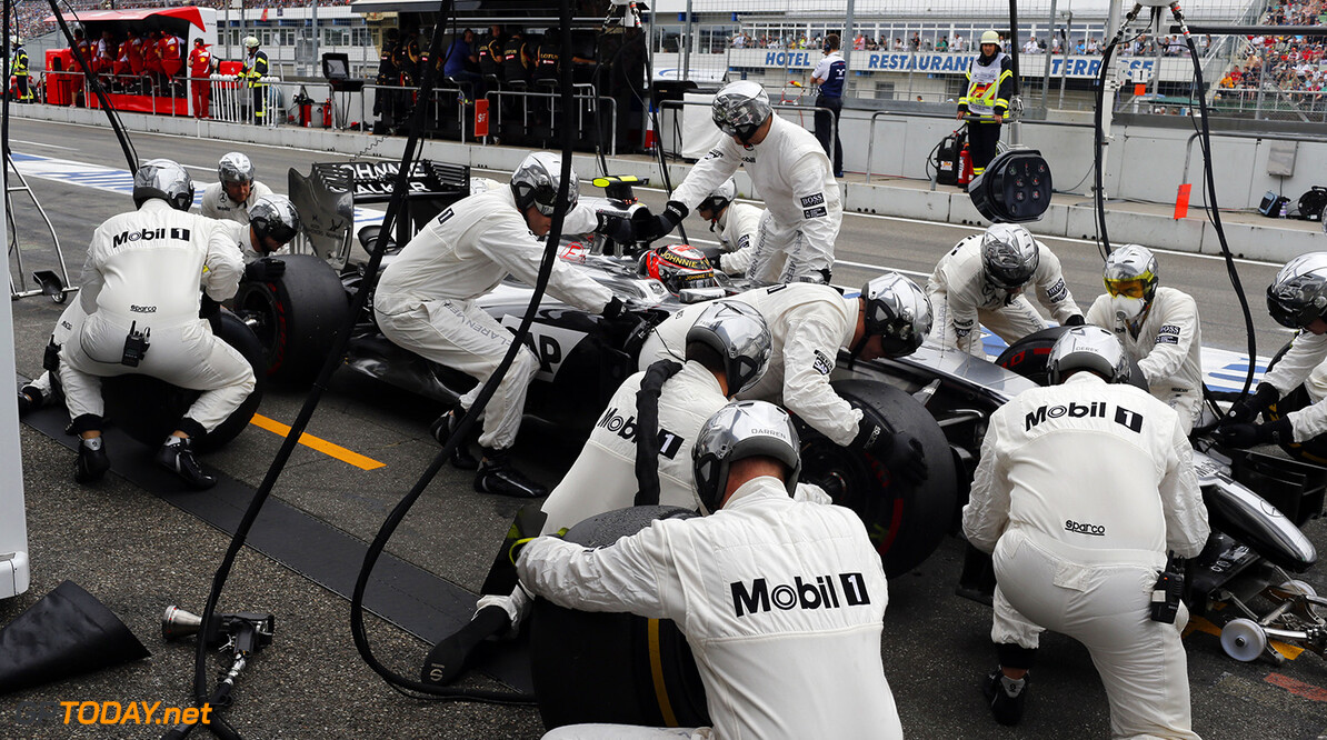 Kevin Magnussen makes a pit stop.  Steven Tee