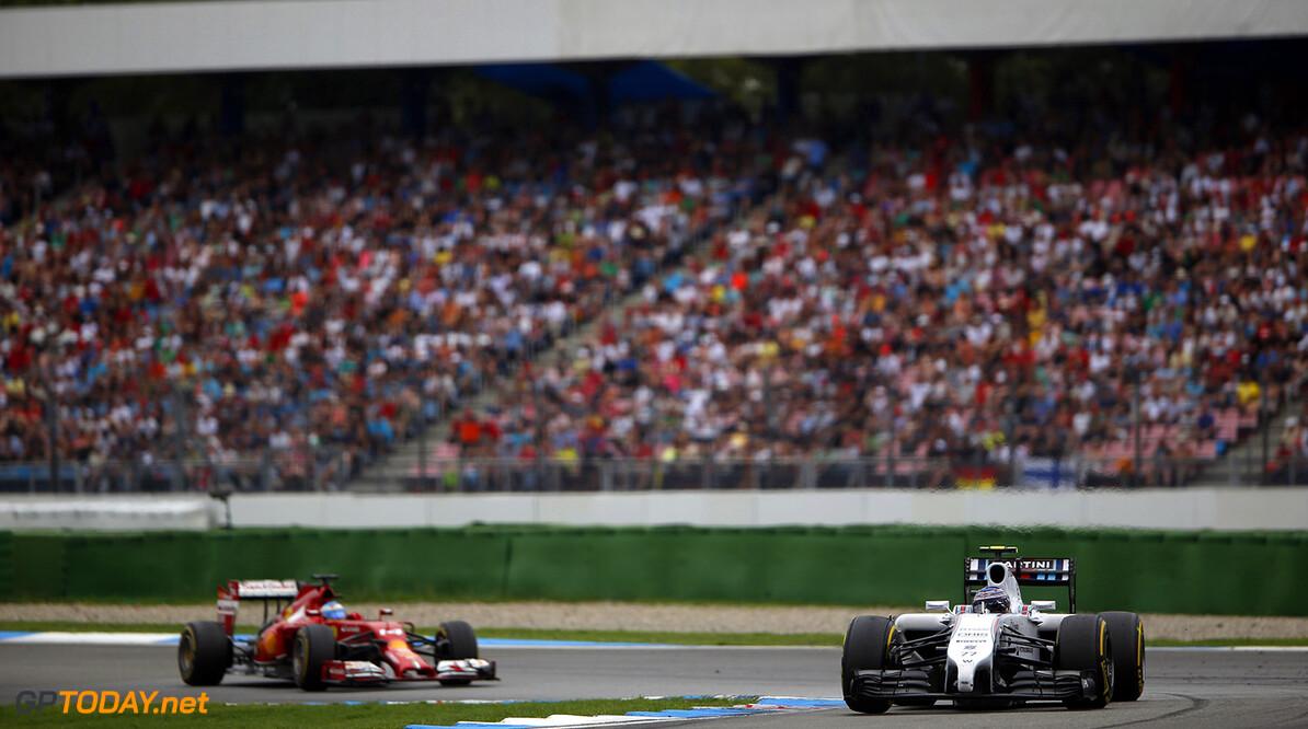 Hockenheimring, Hockenheim, Germany. Sunday 20 July 2014. Valterri Bottas, Williams FW36 Mercedes, leads Fernando Alonso, Ferrari F14T. Photo: Charles Coates/Williams F1. ref: Digital Image _N7T6202      f1 formula 1 formula one german gp Action