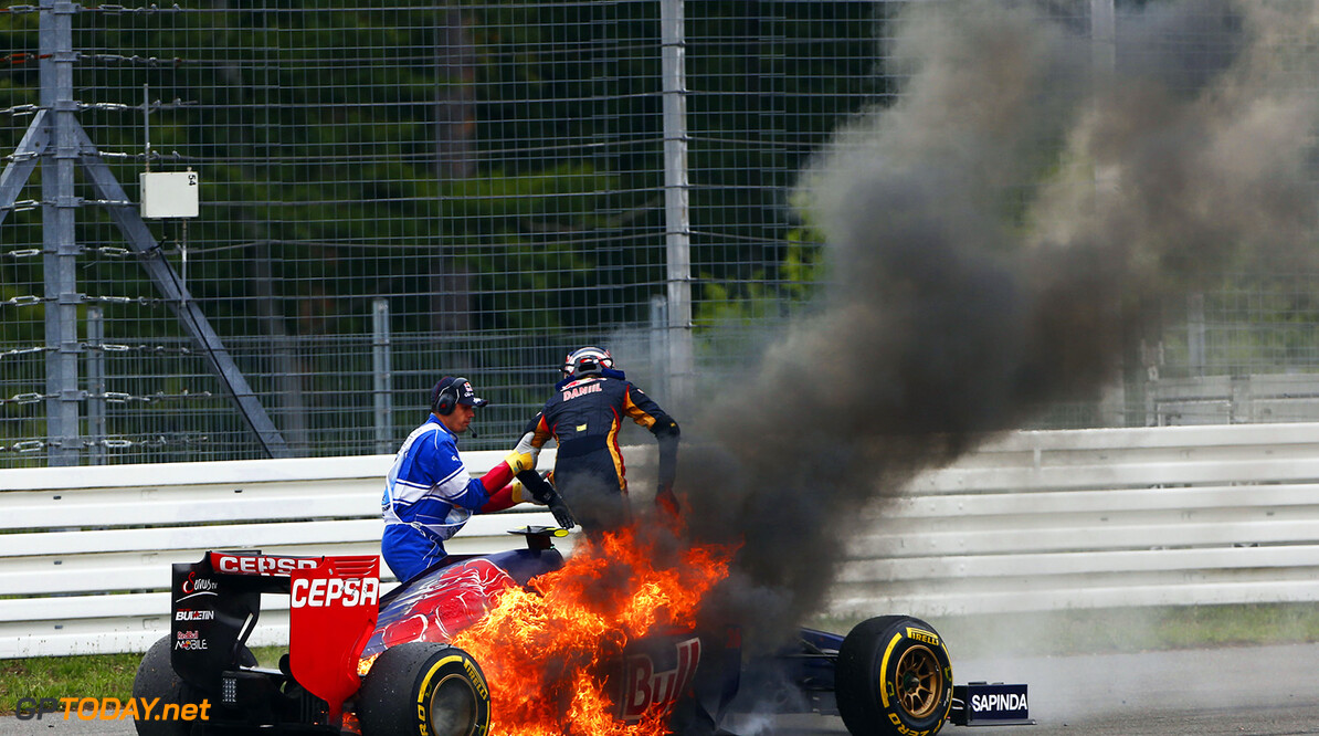 2014 Formula One German Grand Prix, Hockenheimring, Hockenheim, Baden-Wurttemberg,Germany, 17th - 20th July 2014.  The car of Daniil Kvyat, Toro Rosso STR9 Renault, catches fire during the race, Action, World Copyright: (C) Andrew Hone Photographer 2014. Ref:  _ONY9178  Andrew Hone Hockenheim Germany  Formula One F1 German Grand Prix Hockenheimring Hockenheim Germany