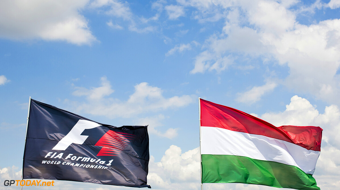 BUDAPEST, HUNGARY - JULY 24:  The Hungarian national flag flaps in the wind next to the FIA flag during previews ahead of the Hungarian Formula One Grand Prix at Hungaroring on July 24, 2014 in Budapest, Hungary.  (Photo by Drew Gibson/Getty Images) F1 Grand Prix of Hungary - Previews Drew Gibson Budapest Hungary  Formula One Racing formula 1 Auto Racing Formula One Grand Prix general view gv