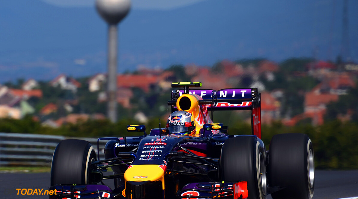 BUDAPEST, HUNGARY - JULY 25:  Daniel Ricciardo of Australia and Infiniti Red Bull Racing drives during practice ahead of the Hungarian Formula One Grand Prix at Hungaroring on July 25, 2014 in Budapest, Hungary.  (Photo by Lars Baron/Getty Images) *** Local Caption *** Daniel Ricciardo F1 Grand Prix of Hungary - Practice Lars Baron Budapest Hungary  Formula One Racing formula 1 Auto Racing Formula One Grand Prix