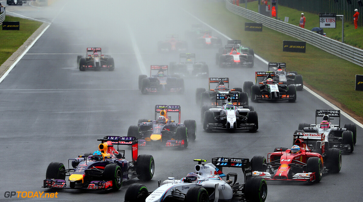 BUDAPEST, HUNGARY - JULY 27:  Sebastian Vettel of Germany and Infiniti Red Bull Racing and Valtteri Bottas of Finland and Williams enter turn one during the Hungarian Formula One Grand Prix at Hungaroring on July 27, 2014 in Budapest, Hungary.  (Photo by Mark Thompson/Getty Images) *** Local Caption *** Valtteri Bottas;Sebastian Vettel F1 Grand Prix of Hungary Mark Thompson Budapest Hungary  Formula One Racing formula 1 Auto Racing Formula One Grand Prix