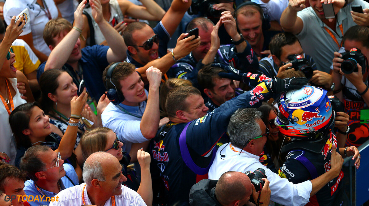 BUDAPEST, HUNGARY - JULY 27:  Daniel Ricciardo of Australia and Infiniti Red Bull Racing celebrates victory with the team in Parc Ferme after the Hungarian Formula One Grand Prix at Hungaroring on July 27, 2014 in Budapest, Hungary.  (Photo by Dan Istitene/Getty Images) *** Local Caption *** Daniel Ricciardo F1 Grand Prix of Hungary Dan Istitene Budapest Hungary  Formula One Racing formula 1 Auto Racing Formula One Grand Prix