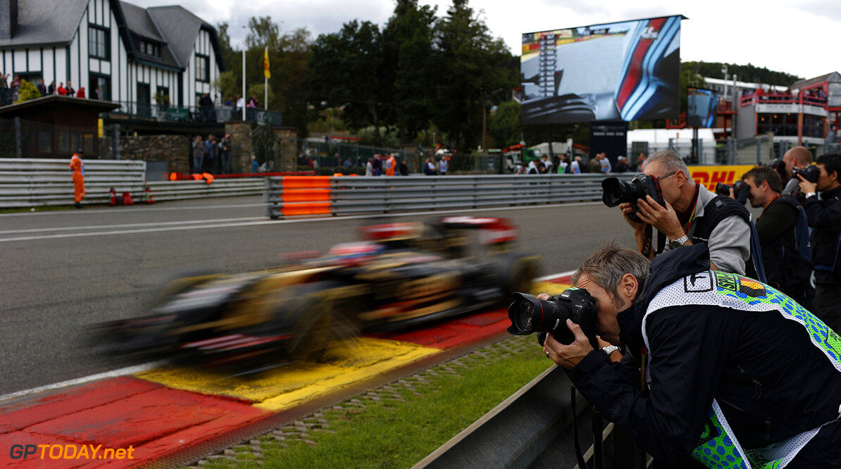 Spa-Francorchamps, Spa, Belgium. Friday 22 August 2014. Romain Grosjean, Lotus E22 Renault, passes some photographers. World Copyright: Steven Tee/Lotus F1. ref: Digital Image _L4R1317  Steven Tee    f1 formula 1 formula one gp Action