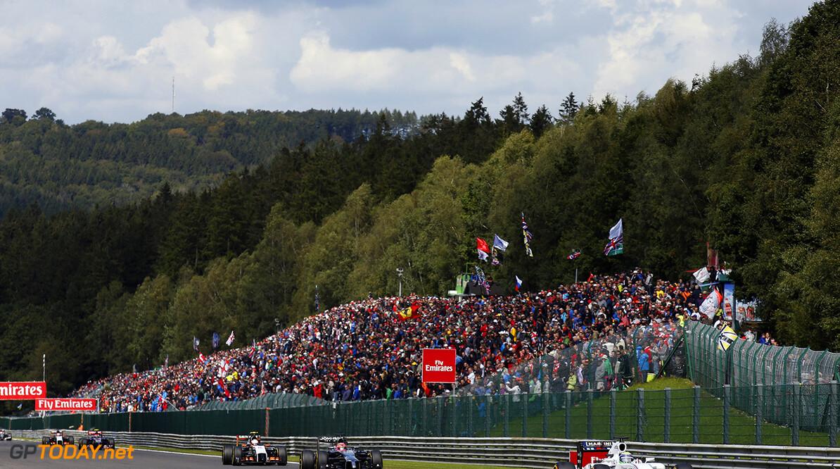 Spa-Francorchamps, Spa, Belgium. Sunday 24 August 2014. Felipe Massa, Williams FW36 Mercedes, leads Jenson Button, McLaren MP4-29 Mercedes. World Copyright: Charles Coates/Williams F1. ref: Digital Image _J5R2354      f1 formula 1 formula one gp Action