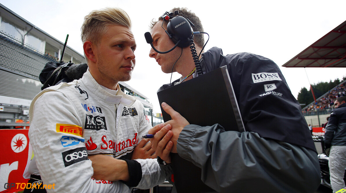 Kevin Magnussen talks with his engineer.