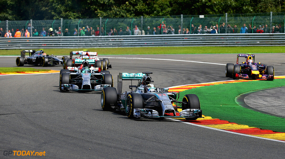 SPA, BELGIUM - AUGUST 24:  Daniel Ricciardo of Australia and Infiniti Red Bull Racing runs wide as Lewis Hamilton of Great Britain and Mercedes GP leads Nico Rosberg of Germany and Mercedes GP during the Belgian Grand Prix at Circuit de Spa-Francorchamps on August 24, 2014 in Spa, Belgium.  (Photo by Clive Mason/Getty Images) *** Local Caption *** Daniel Ricciardo;Lewis Hamilton;Nico Rosberg F1 Grand Prix of Belgium Clive Mason Spa Belgium  Formula One Racing formula 1 Auto Racing Formula One Grand Prix Belgium Grand Prix Belgian Formula One Grand Prix
