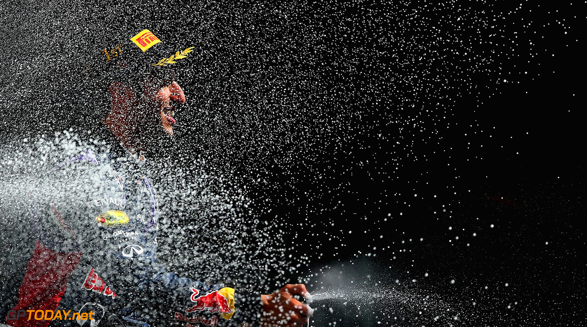 SPA, BELGIUM - AUGUST 24:  Daniel Ricciardo of Australia and Infiniti Red Bull Racing celebrates on the podium after winning the Belgian Grand Prix at Circuit de Spa-Francorchamps on August 24, 2014 in Spa, Belgium.  (Photo by Clive Mason/Getty Images) *** Local Caption *** Daniel Ricciardo F1 Grand Prix of Belgium Clive Mason Spa Belgium  Formula One Racing formula 1 Auto Racing Formula One Grand Prix Belgium Grand Prix Belgian Formula One Grand Prix