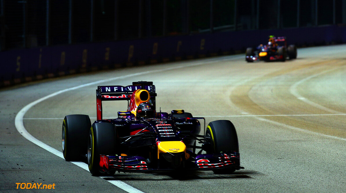 SINGAPORE - SEPTEMBER 21:  Sebastian Vettel of Germany and Infiniti Red Bull Racing leads Daniel Ricciardo of Australia and Infiniti Red Bull Racing during the Singapore Formula One Grand Prix at Marina Bay Street Circuit on September 21, 2014 in Singapore, Singapore.  (Photo by Mark Thompson/Getty Images) *** Local Caption *** Sebastian Vettel;Daniel Ricciardo F1 Grand Prix of Singapore Mark Thompson Singapore Singapore  Formula One Racing formula 1 Auto Racing Formula One Grand Prix Marina Bay Street Circuit Singapore Grand Prix