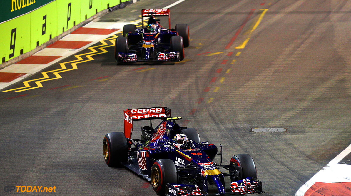 SINGAPORE - SEPTEMBER 21:  Daniil Kvyat of Russia and Scuderia Toro Rosso drives ahead of Jean-Eric Vergne of France and Scuderia Toro Rosso during the Singapore Formula One Grand Prix at Marina Bay Street Circuit on September 21, 2014 in Singapore, Singapore.  (Photo by Clive Mason/Getty Images) *** Local Caption *** Jean-Eric Vergne;Daniil Kvyat F1 Grand Prix of Singapore Clive Mason Singapore Singapore  Formula One Racing formula 1 Auto Racing Formula One Grand Prix Marina Bay Street Circuit Singapore Grand Prix