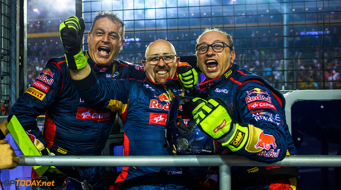498756423PF006_F1_Grand_Pri SINGAPORE - SEPTEMBER 21:  Toro Rosso mechanics celebrate finishing 6th place in the Singapore F1 Grand Prix at Marina Bay Street Circuit on September 21, 2014 in Singapore.  (Photo by Peter Fox/Getty Images) F1 Grand Prix of Singapore Peter Fox Singapore Singapore  Formula One Racing formula 1 Auto Racing Formula One Grand Prix Marina Bay Street Circuit Singapore Grand Prix