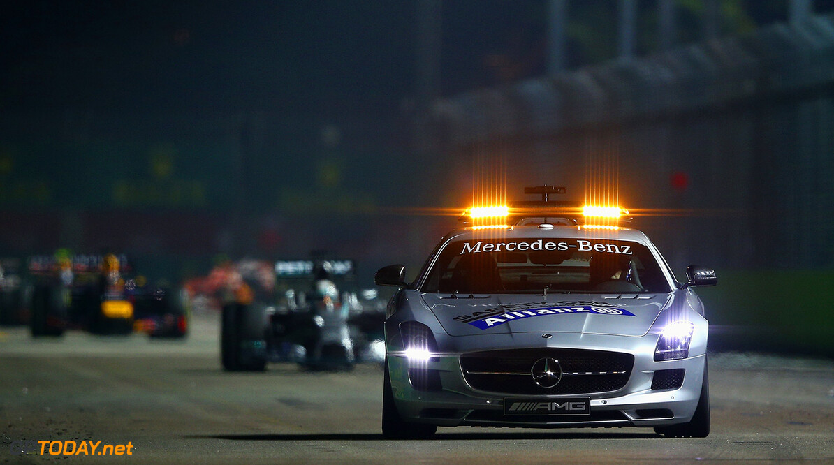 SINGAPORE - SEPTEMBER 21:  The Safety Car drives ahead of Lewis Hamilton of Great Britain and Mercedes GP and Sebastian Vettel of Germany and Infiniti Red Bull Racing during the Singapore Formula One Grand Prix at Marina Bay Street Circuit on September 21, 2014 in Singapore, Singapore.  (Photo by Clive Mason/Getty Images) *** Local Caption *** Lewis Hamilton;Sebastian Vettel F1 Grand Prix of Singapore Clive Mason Singapore Singapore  Formula One Racing formula 1 Auto Racing Formula One Grand Prix Marina Bay Street Circuit Singapore Grand Prix